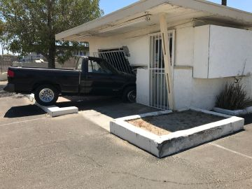 Stolen Truck Hits Car, Crashes into Motel