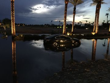 Drivers Get Caught in Flood Waters