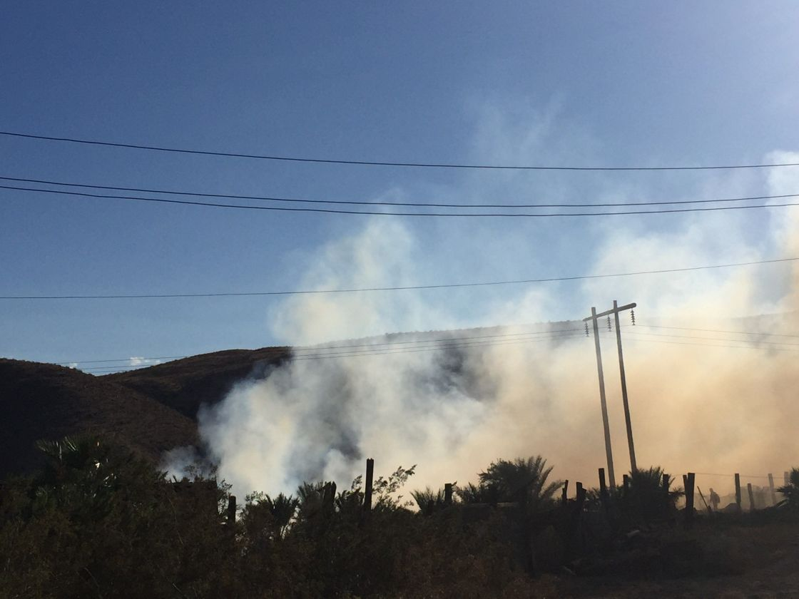 Fire Burns in Field of Mulch in Indio Hills