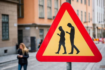 Board Passes Resolution to Ban Cellphone Use in Crosswalks