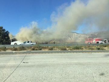 Tour Bus Catches Fire on Freeway in Cabazon