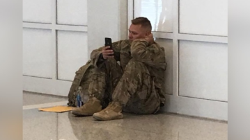 Viral photo: Soldier delayed in airport watches daughter's birth on FaceTime