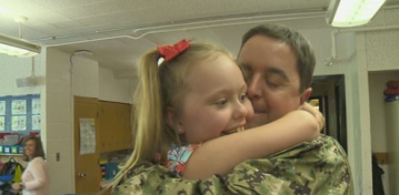 US Navy reserves officer surprises daughter after long deployment