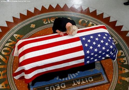 Cindy McCain kisses husband's casket at Arizona service, daughter Meghan weeps