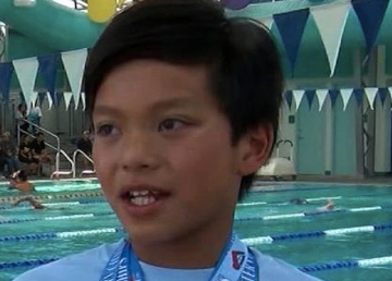 10-year-old named Clark Kent beats Michael Phelps record in California