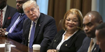 Trump praised as 'pro-black' at White House prison reform event