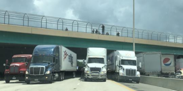 Trucks line up under Orlando overpass to stop man threatening to jump