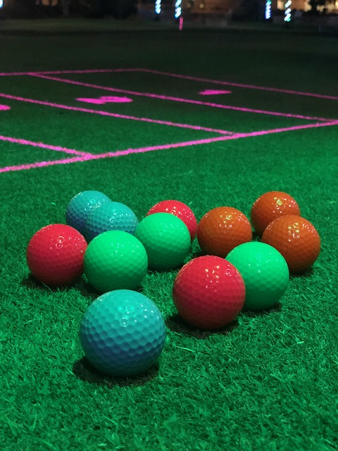 Light Up The Dark With Shots In The Night Golf Experience