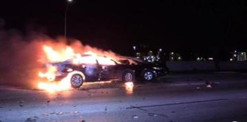 Good Samaritan Jumps Freeway Divider to Save Woman From Burning Car