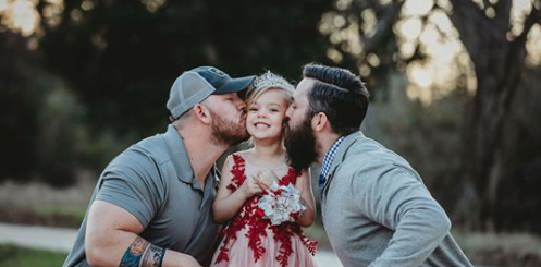 Daddy-daughter dance photos with dad, soon-to-be stepfather widely shared on social media