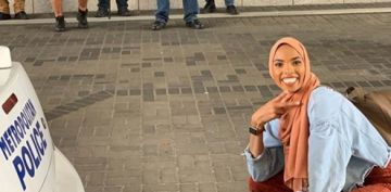 Muslim woman poses in front of anti-Islam protesters in viral photo