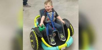 High school robotics team builds customized toy car for 2-year-old unable to walk on his own