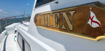 Two teens swept out into the ocean prayed for help. Then along came a boat named 'Amen.'