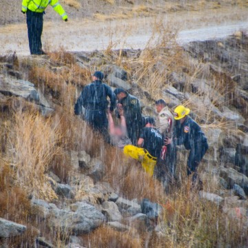 Woman Swept Down Storm Channel During Rainstorm, Rescued by Firefighters