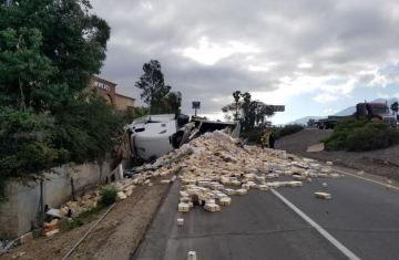 Truck Overturns in Banning, Spilling Butter on Freeway