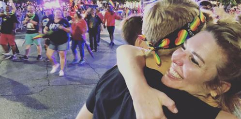 These moms give out hugs at Pride parades for people without their parents' support