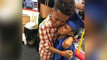 'I'm just so happy': Photo of brother hugging little sister at her pre-K graduation goes viral