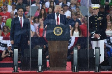 Trump Praises Armed Forces As Military Aircraft Roars Overhead During 'Salute to America' Event