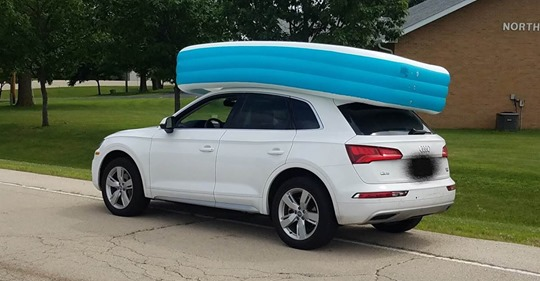 Mom arrested for driving with kids on top of SUV in inflatable pool
