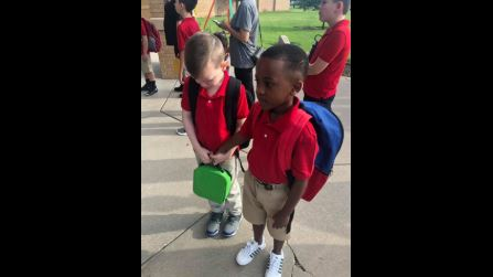 When a boy with autism was overwhelmed on the first day of school, another little boy held his hand