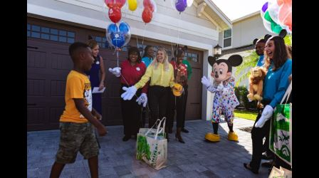 Boy who spent his Disney vacation savings to feed Dorian evacuees gets a surprise trip to Disney World