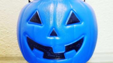 Facebook post raises awareness for autism with blue Halloween buckets