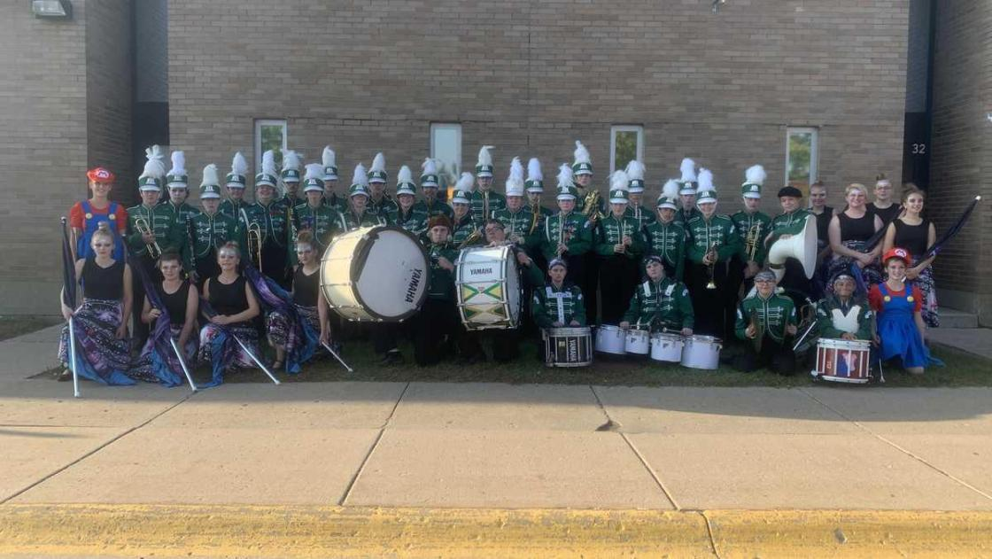 Football team with no band invites high school band with no team to play at their game