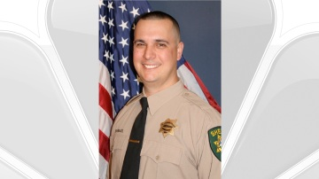 Deputy shot and killed in California; two people arrested