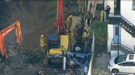 Man Rescued from Deep Down a Construction Hole