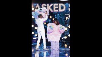 'Masked Singer' kicks off legendary singer in surprise elimination