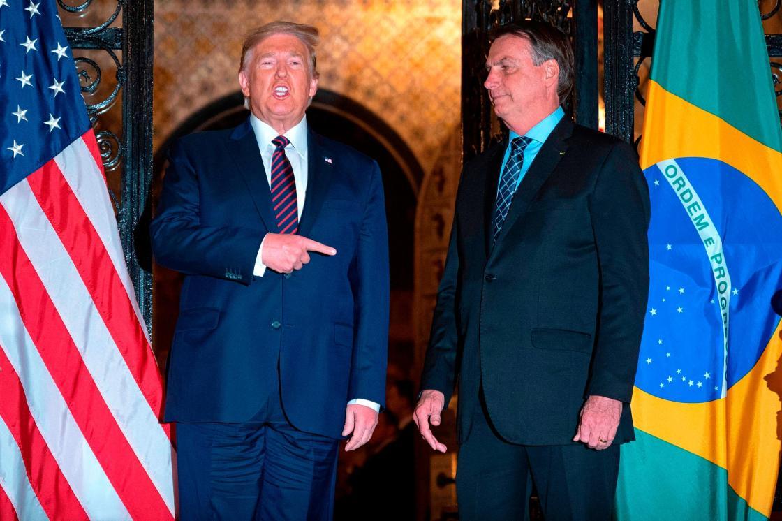 Brazilian president's press secretary tests positive for coronavirus, days after meeting Trump