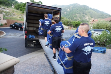 A moving company started by former student-athletes helps domestic violence victims flee abusive homes