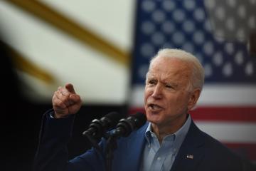 Biden gets into testy exchange with man over gun rights