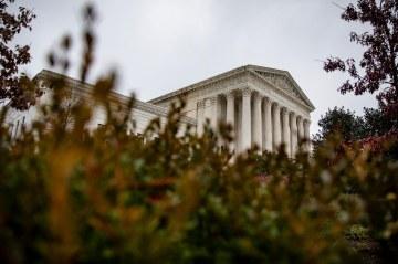 Supreme Court delays oral arguments scheduled for April