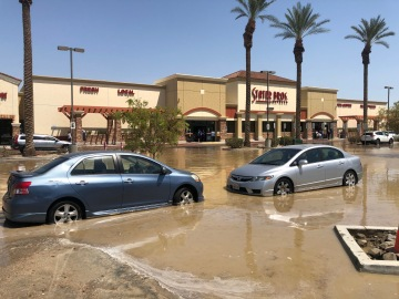 Vehicle hits fire hydrant causing parking lot to flood