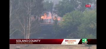 Homes burn, thousands evacuate as wildfires tear through Northern California