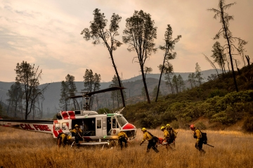 California wildfires have burned 1.25 million acres, but firefighters say the weather is now helping