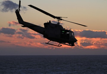 Military helicopter shot at over Virginia, injuring a crew member