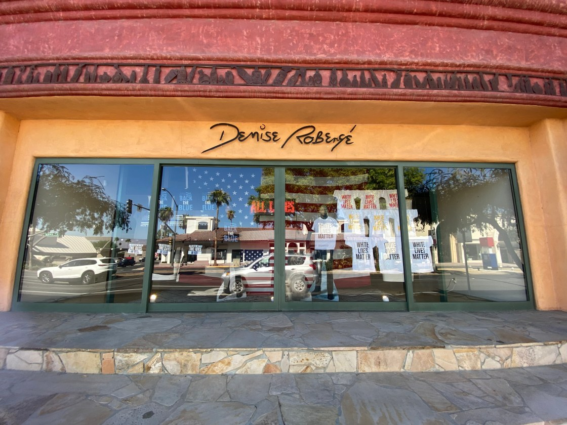 Business on El Paseo draws criticism over new political window display