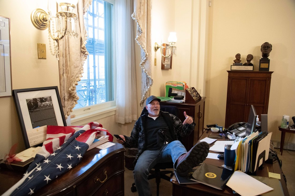 Man Photographed at Nancy Pelosi's Desk Reportedly Arrested