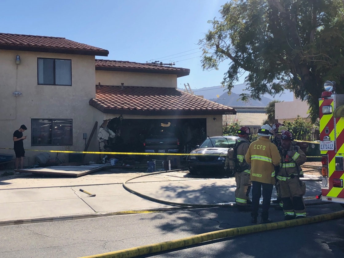 Driver trapped in car following crash, garage fire in Cathedral City