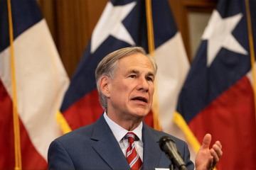 Texas governor lifts mask mandate and allows businesses to open at 100% capacity