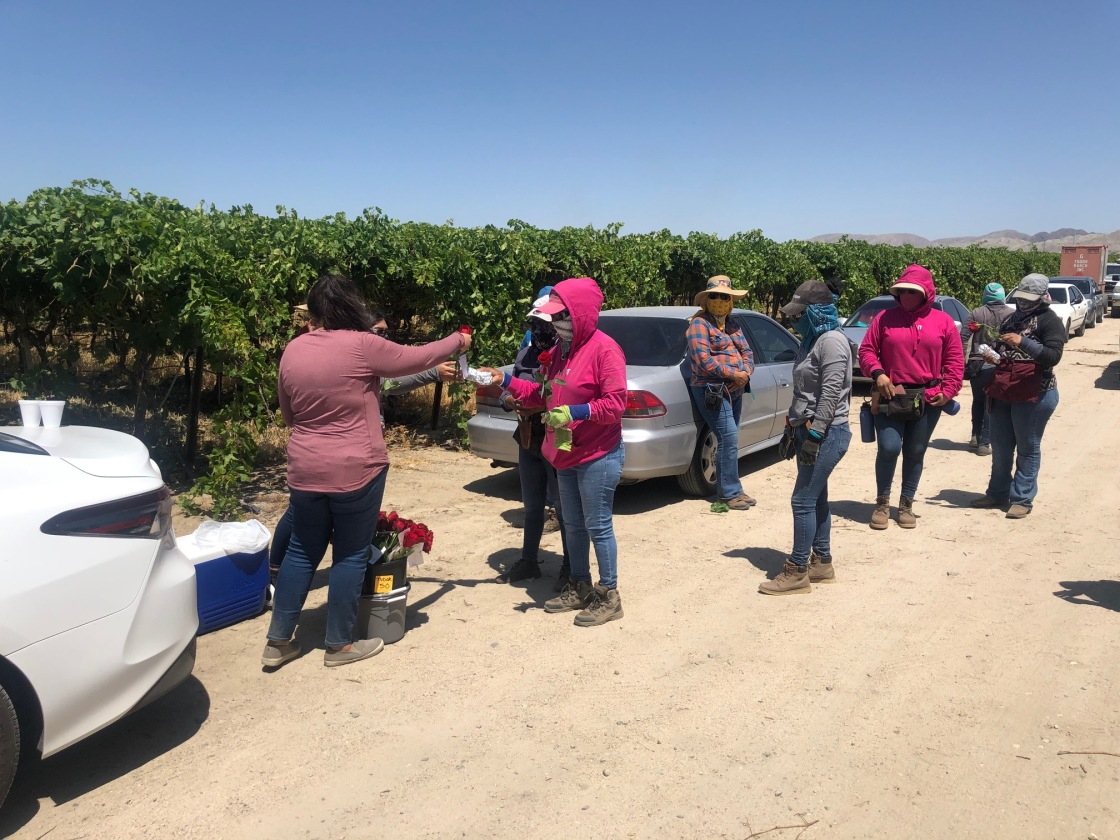 Local farm-working mothers honored with food, roses and gift bags