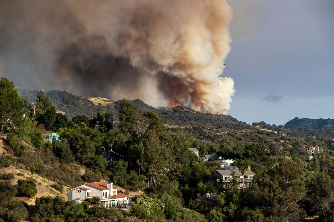 Arson suspect arrested in uncontrolled fire burning near Los Angeles