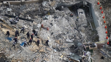 Rescue workers at Surfside building collapse find bodies of two children
