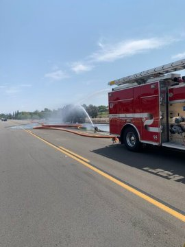 Fire Consumes Trash Truck, Causing Explosion That Injures Firefighters